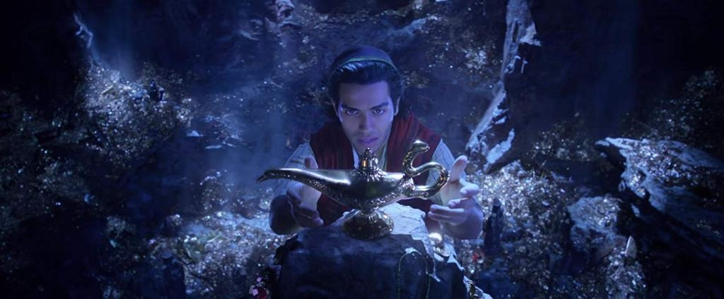 Aladdin reaching for the lamp in the cave of wonders