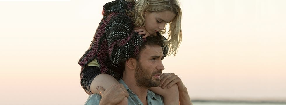 Still from the movie Gifted showing McKenna Grace on Chris Evans' shoulders