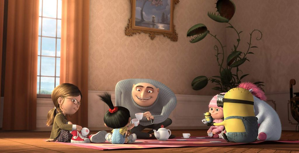 Still from Despicable movie of Gru having a tea party with his girls and a minion