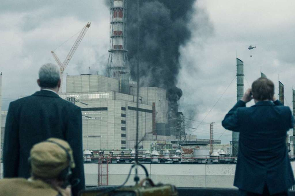 TV still from Chernobyl with Jared Harris and Stellan Skarsgard looking at the destruction.