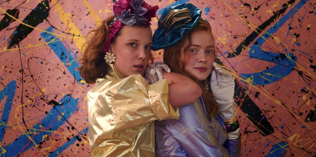 Movie still of Millie Bobby Brown and Sadie Sink from Strangers Thing 3.
