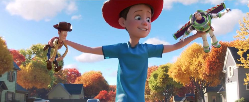 Movie still from Toy Story 4 of a young Andy playing with Woody and Buzz.