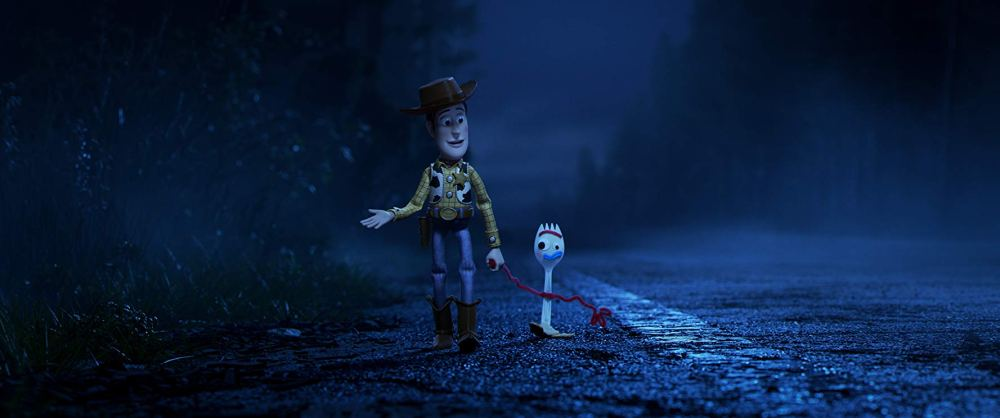 Movie still of Woody and Forky from Toy Story 4.