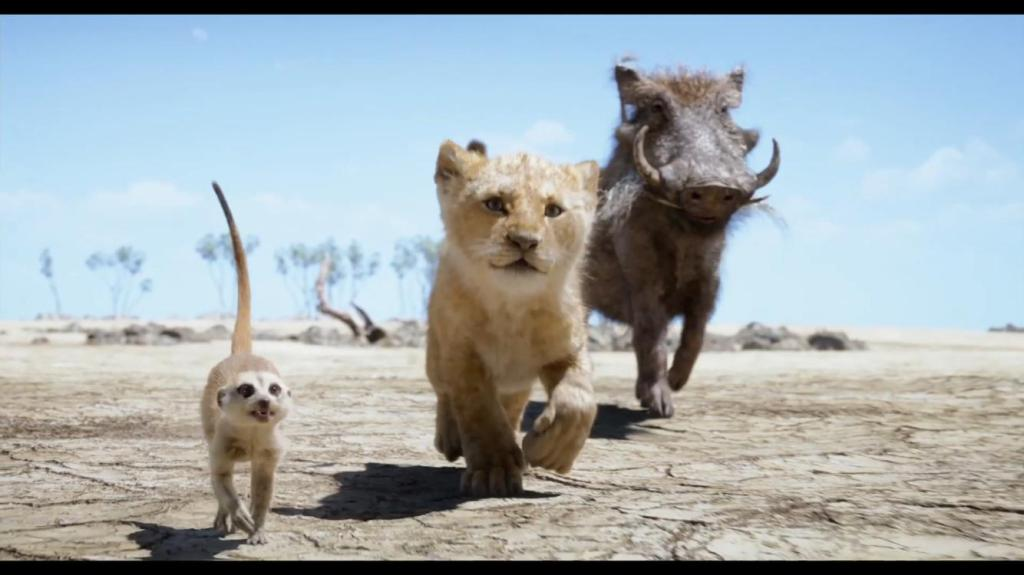 Timon (Billy Eichner), young Simba (JD McCrary) and Pumbaa (Seth Rogen) in The Lion King (2019)