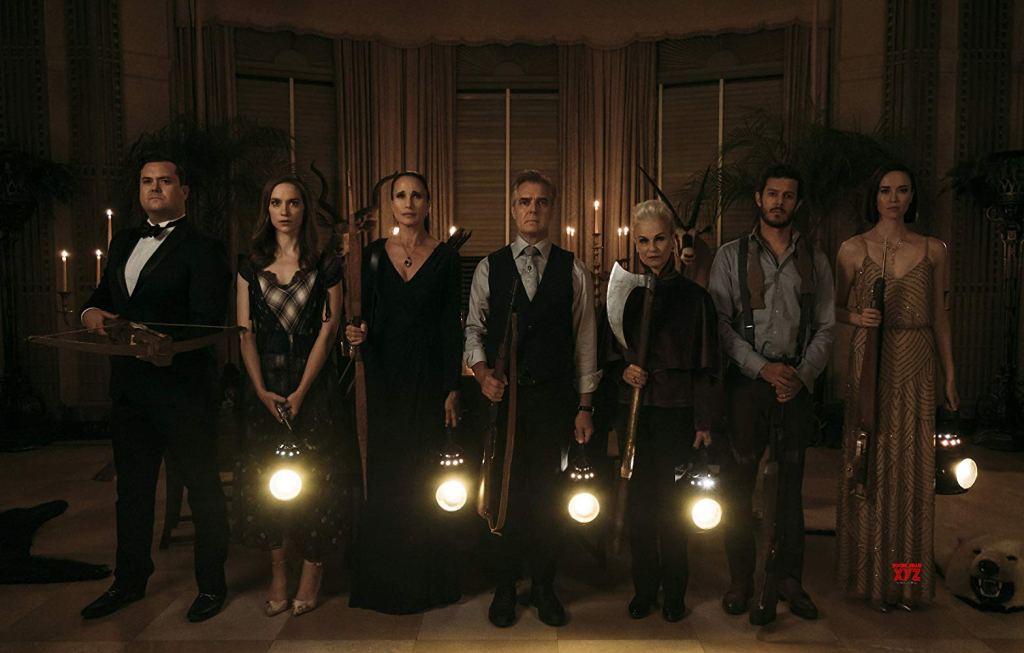 (L-R) Kristian Bruun, Melanie Scrofano, Andie MacDowell, Henry Czerny, Nicky Guadagni, Adam Brody and Elyse Levesque in 'Ready or Not' (2019)