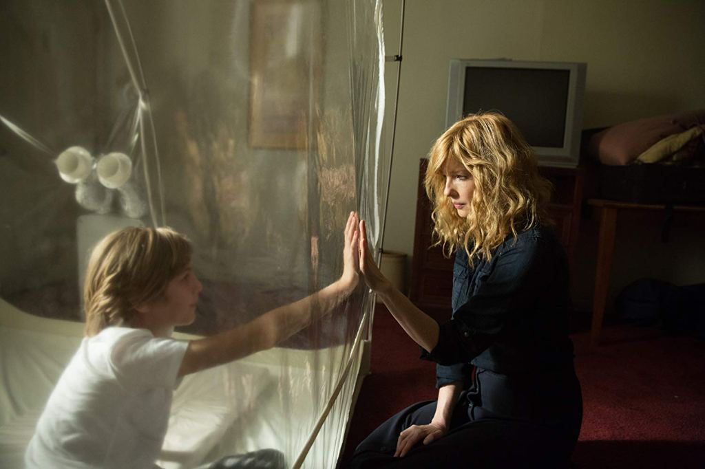 Charlie Shotwell and Kelly Reilly in the 2019 Netflix film, 'Eli'